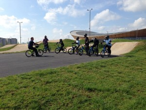 Students learning techniques and skills on how to BMX